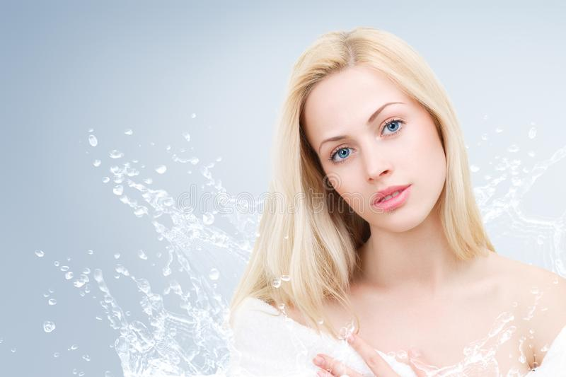 Young beautiful woman portrait with water splash stock image