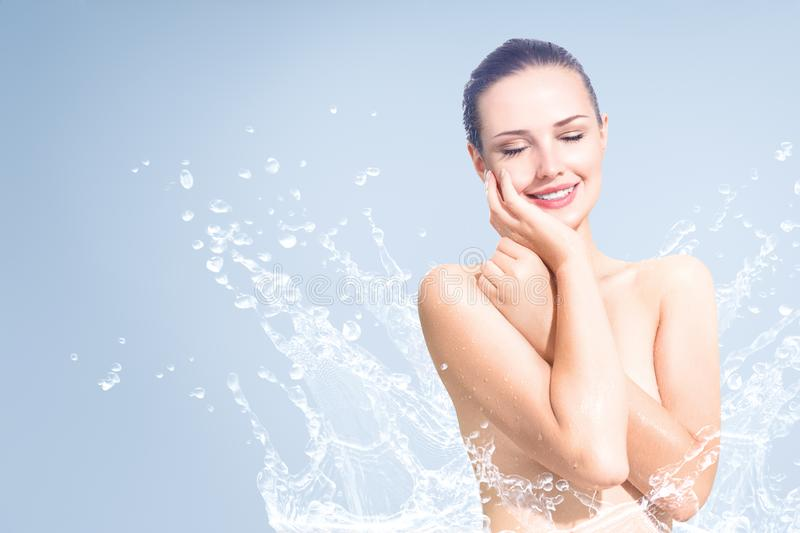 Young beautiful woman portrait with water splash royalty free stock photography