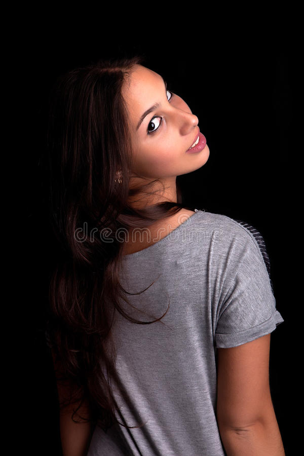 Young and beautiful woman posing stock photography