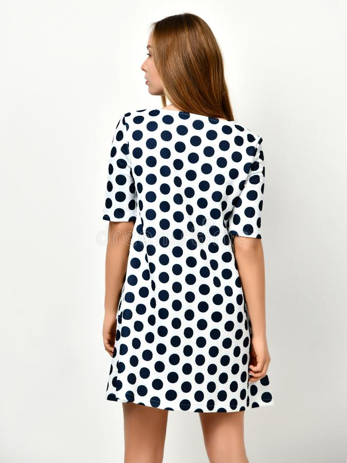 Young beautiful woman posing in new casual black and white dotted dress stock image