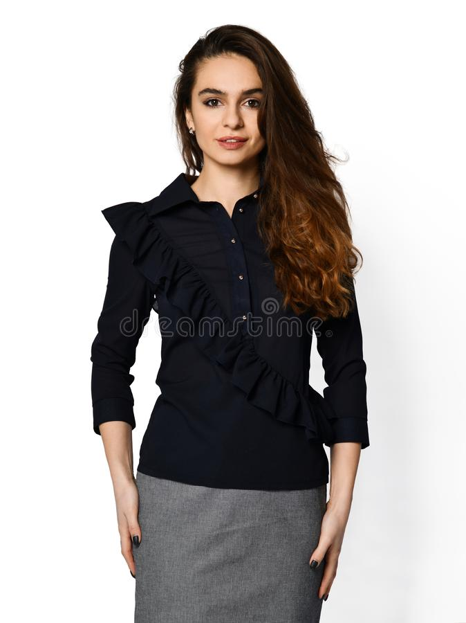 Young beautiful woman posing in new casual office blouse. On a white background stock photo