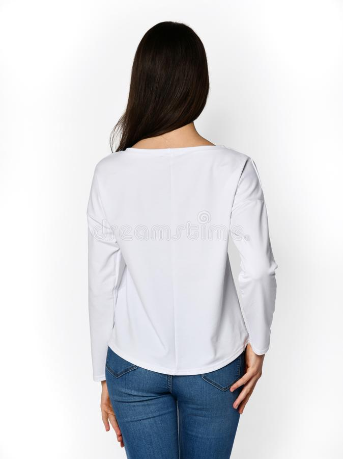 Young beautiful woman posing in new casual office blouse. On a white background royalty free stock image