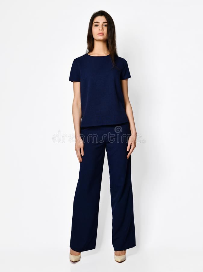 Young beautiful woman posing in new dark blue blouse with pants fashion casual summer costume royalty free stock photography