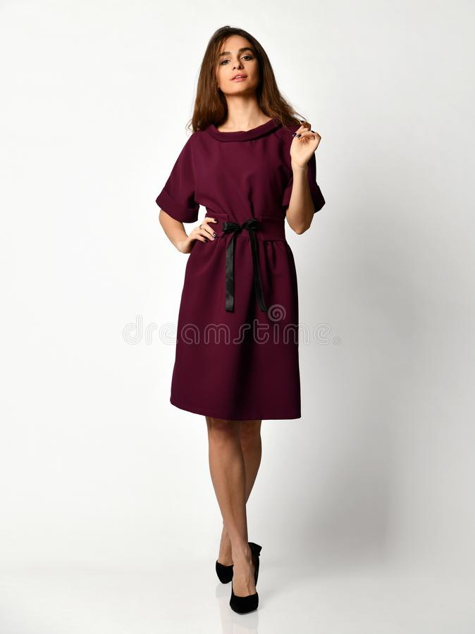 Young beautiful woman posing in new fashion casual purple winter dress smiling on white. Background full body royalty free stock images