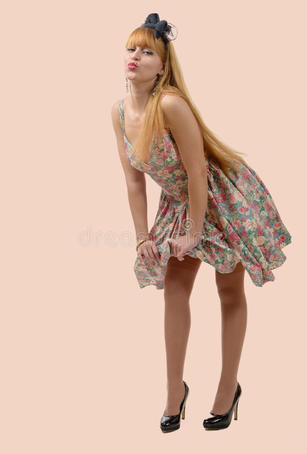 Young beautiful woman posing, retro styling royalty free stock photography