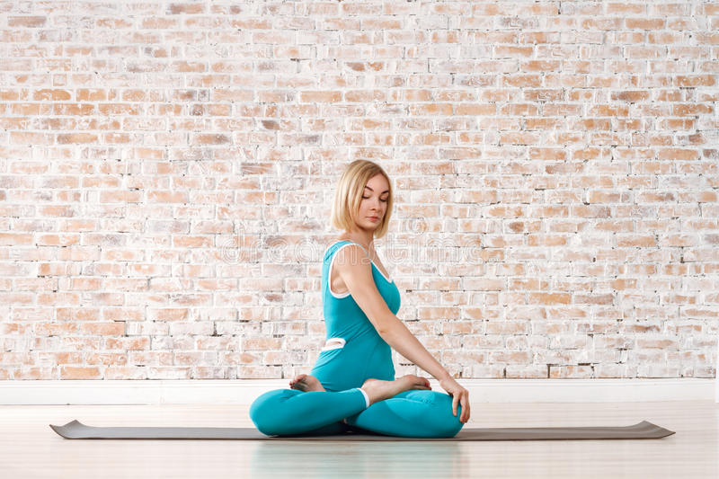 Young Beautiful Woman Practicing Yoga royalty free stock images