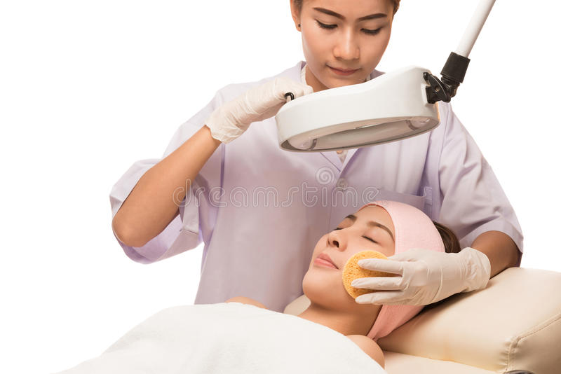 Young beautiful woman receiving cosmetic facial mask in spa stock image