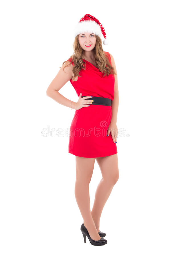 Young beautiful woman in red dress and santa hat isolated on white. Background royalty free stock image