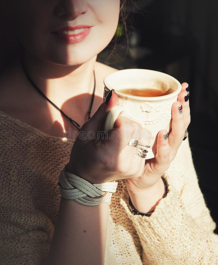 Young beautiful woman relax with cup of tea stock image