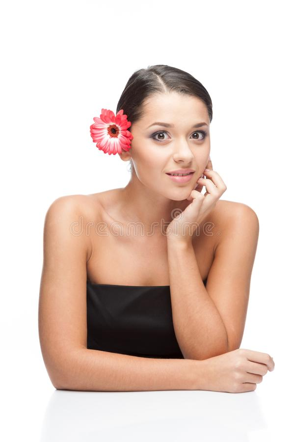 Young beautiful woman relaxing with gerbera flower at spa isolated royalty free stock images