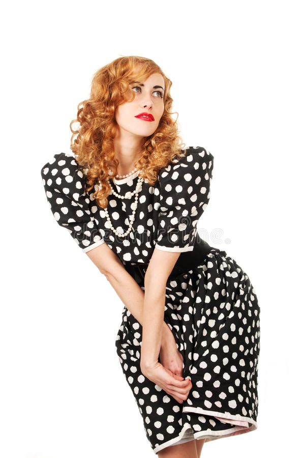 Young beautiful woman in retro dress stock photography