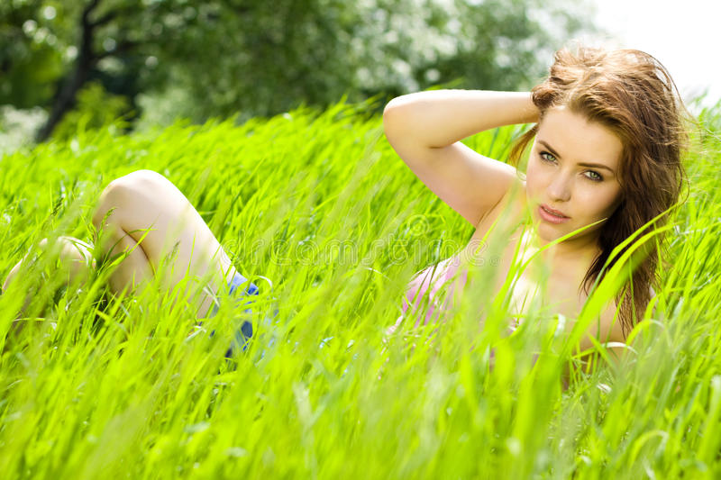 Download Young Beautiful Woman Reverie In Grass Stock Image - Image: 14667843
