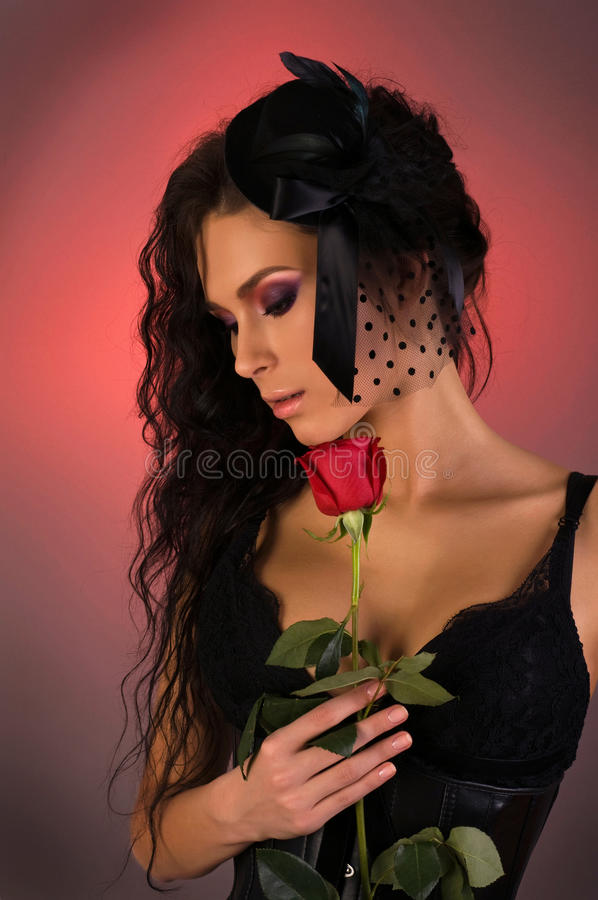 Young beautiful woman with rose in her royalty free stock photo