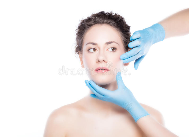 Young beautiful woman`s skin review before treatment. Aesthetic medicine. Young beautiful woman`s skin review before treatment. Anti-aging skincare and plastic royalty free stock photography