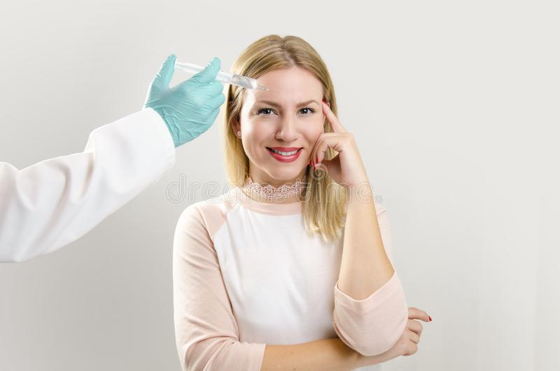 Young, beautiful woman, satisfied with her beauty corrections royalty free stock photography
