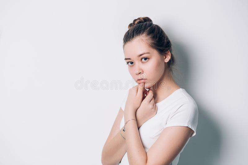 Young beautiful woman serious and concerned looking worried and thoughtful facial expression feeling depressed stock photography