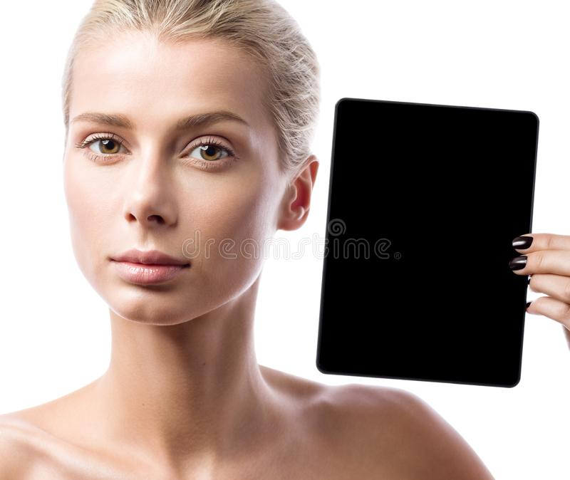 Young beautiful woman shows a black tablet. Portrait isolated stock photos