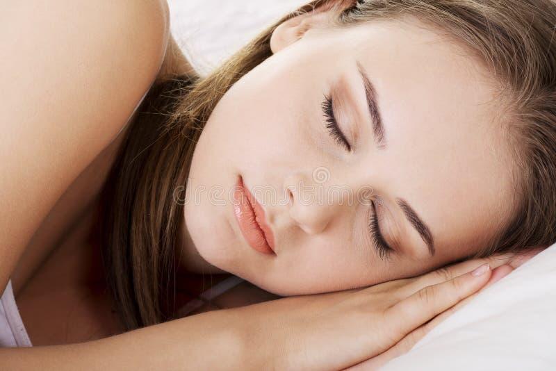 Young beautiful woman sleeping stock photo