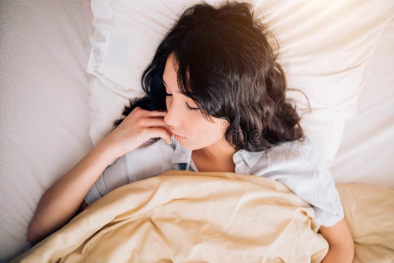 Young beautiful woman sleeping in bed, relaxing in the morning royalty free stock images