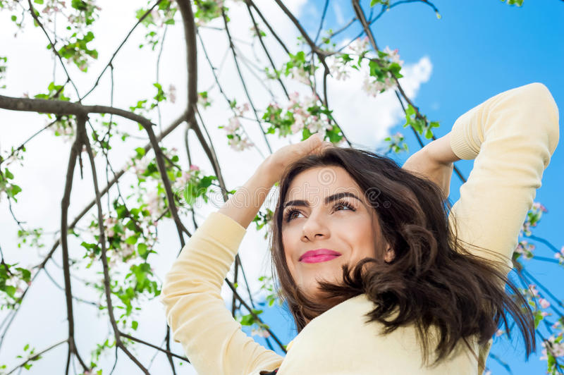 Young beautiful woman smiling and blue sky on back stock photos