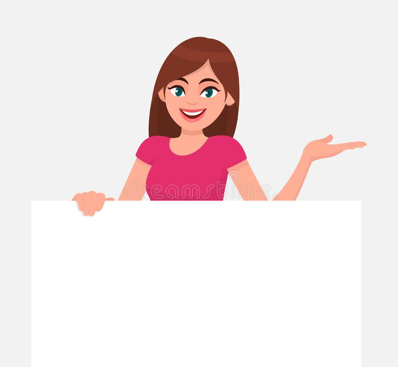Young beautiful woman smiling and holding a blank / empty sheet of white paper or board & gesturing hand to copy space. Human emotion & body language concept stock illustration
