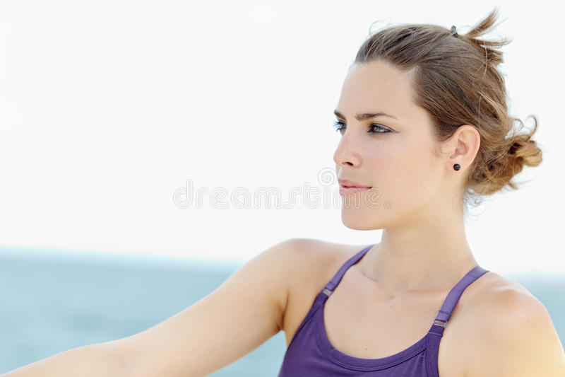 Young beautiful woman smiling and looking away stock photography