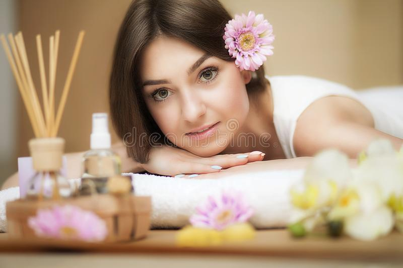 Young beautiful woman on the spa. Aroma oil and butter. Nice look. The concept of health and beauty. Better In the spa salon. royalty free stock photography