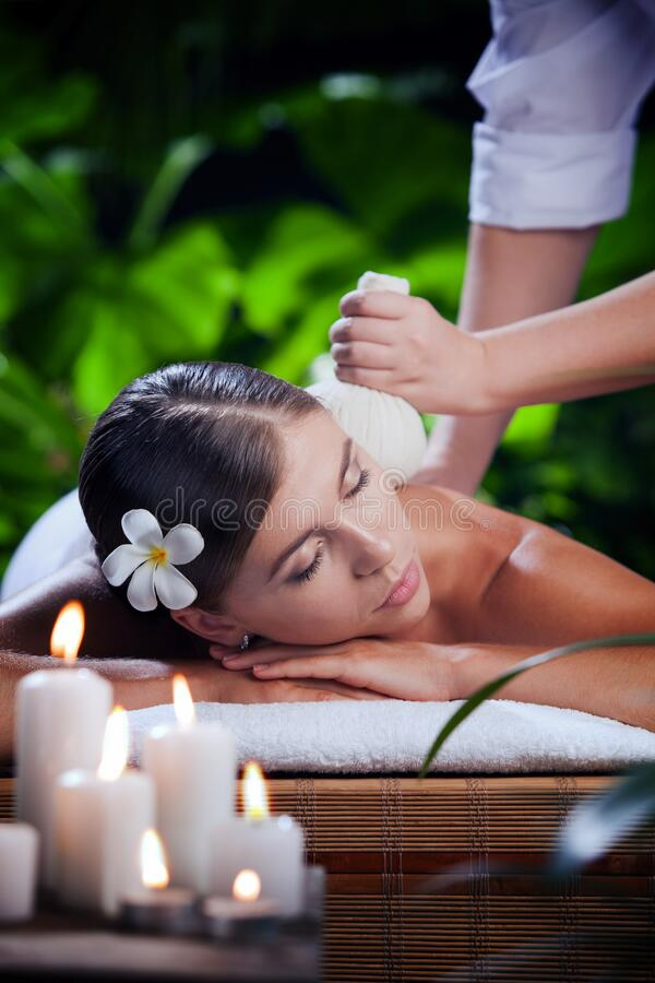 Young beautiful woman in spa environment. Portrait of young beautiful woman in spa environment royalty free stock photo