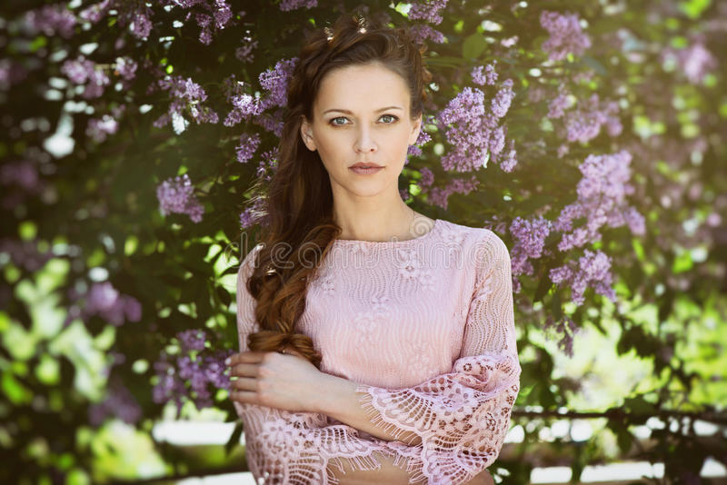 Young beautiful woman in spring blossom trees. stock photography