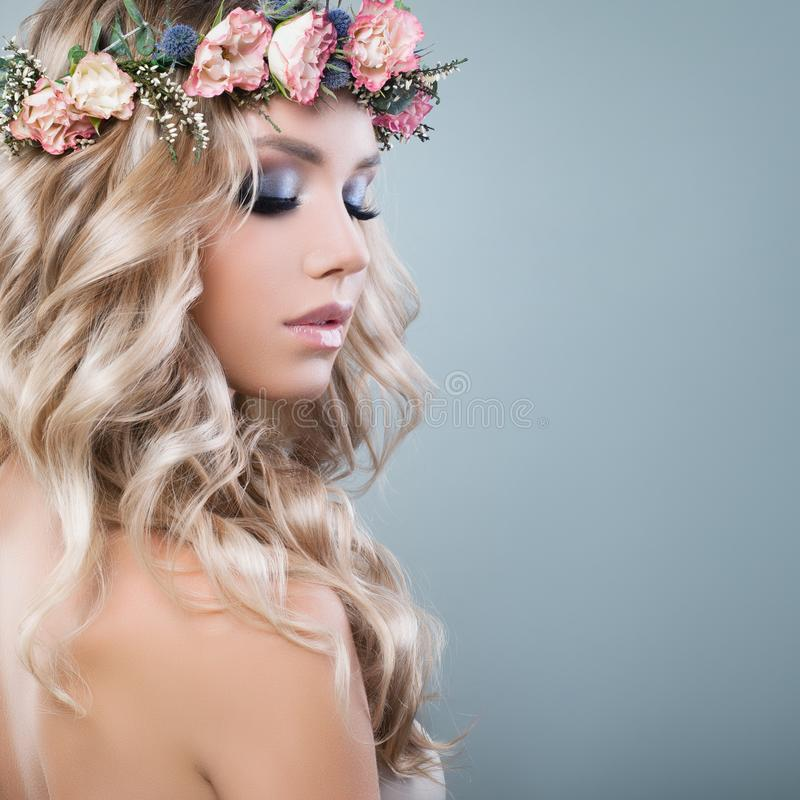 Young Beautiful Woman in Spring Flowers Wreath royalty free stock image