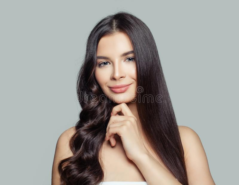 Young beautiful woman with straight and curly hairstyle. Hair styling and hair care concept. Young brunette woman royalty free stock image