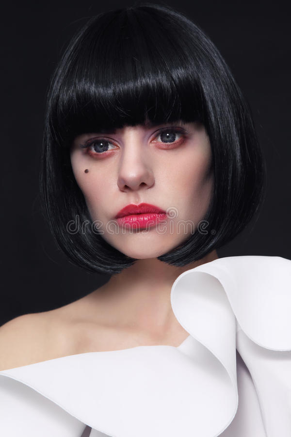 Young beautiful woman with stylish bob haircut and cosplay contact lenses royalty free stock image