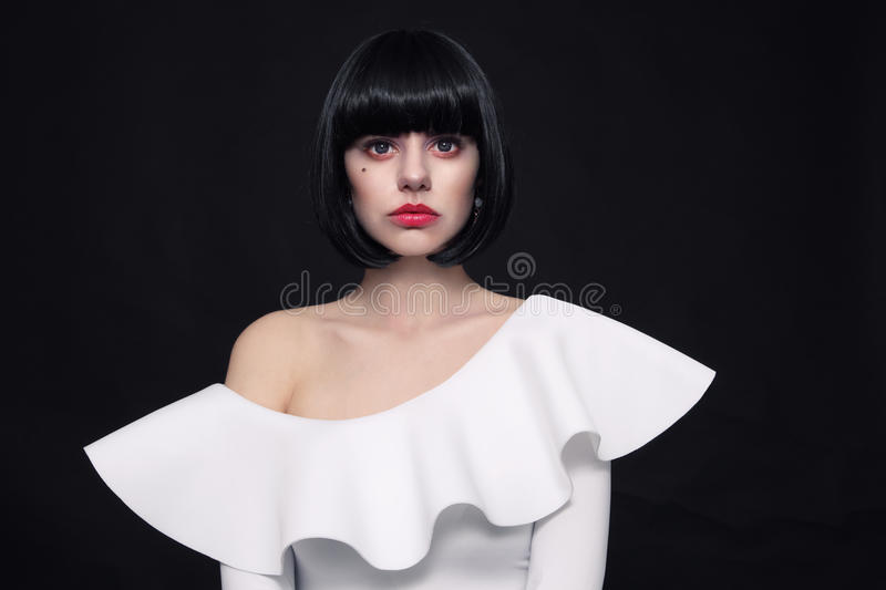 Young beautiful woman with stylish bob haircut and cosplay contact lenses stock image