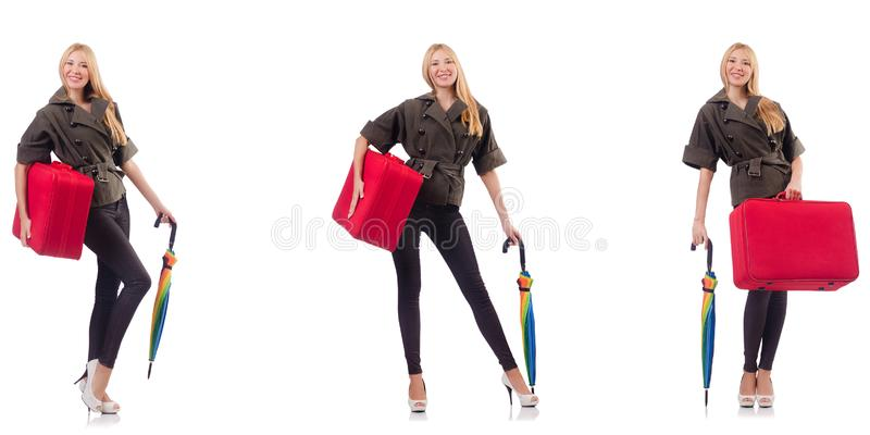 Young beautiful woman with suitcase and umbrella isolated on whi. The young beautiful woman with suitcase and umbrella isolated on whi stock photos