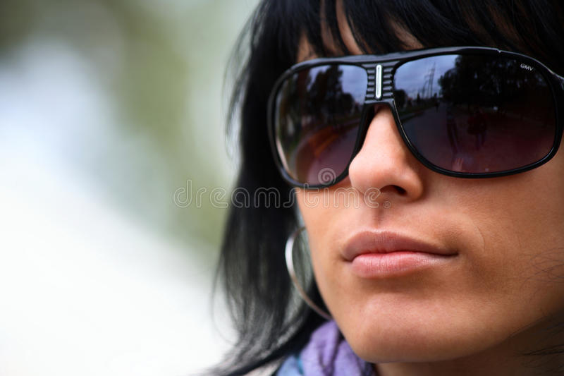 Young beautiful woman in sunglasses stock photography