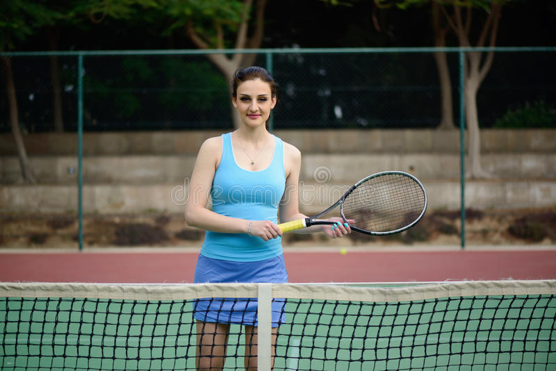 Young beautiful woman tennis player practice in tennis court stock photo
