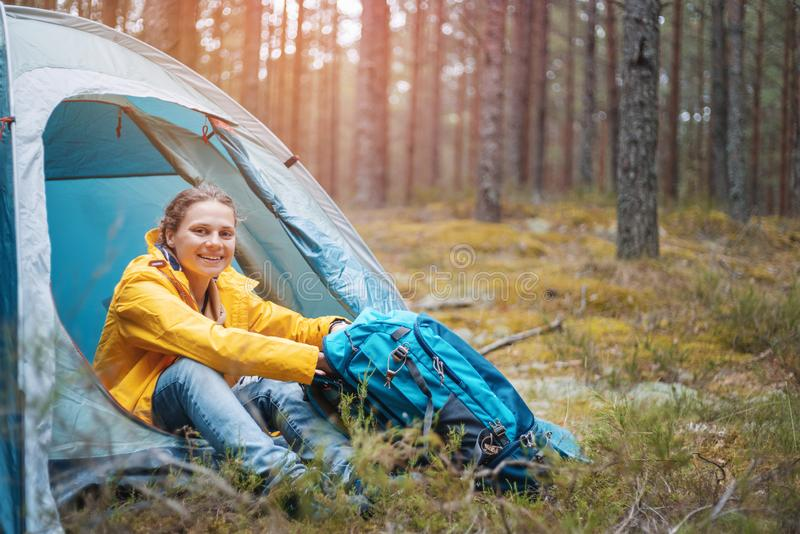 Young beautiful woman with a tent forest, camping, solo travel, nature concept stock photo