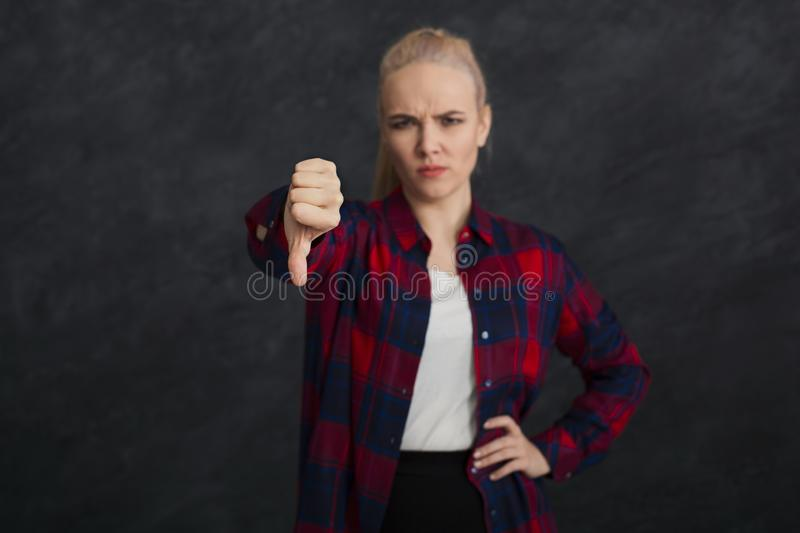 Young beautiful woman with thumb down portrait royalty free stock images