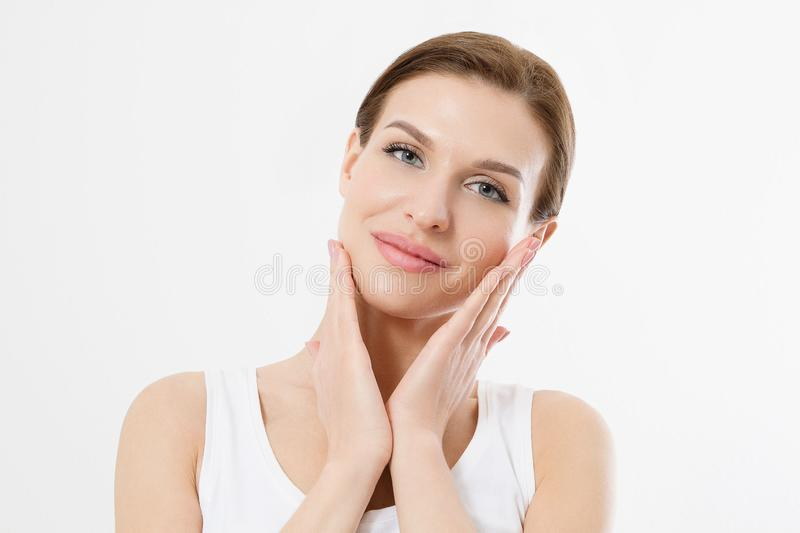 Young beautiful woman touching clean fresh face skin . Anti aging concept. Facial treatment . Cosmetology , Beauty and spa. stock photography