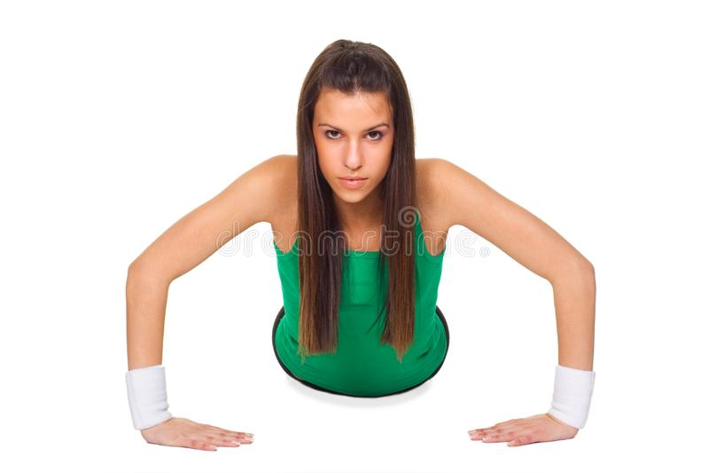Young beautiful woman in training pushup