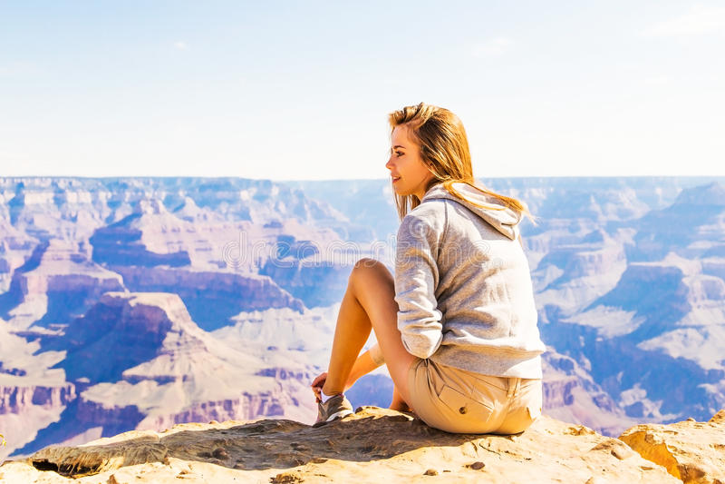 Young beautiful woman traveling, Grand Canyon, USA stock photography