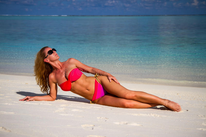 Young beautiful woman on a tropical beach. Maldives beach with a young woman panorama. Luxury water villas, in exotic blue lagoon. Full screen screen background stock photos