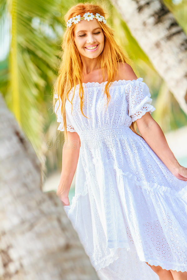 Young beautiful woman on tropical tree background stock photos