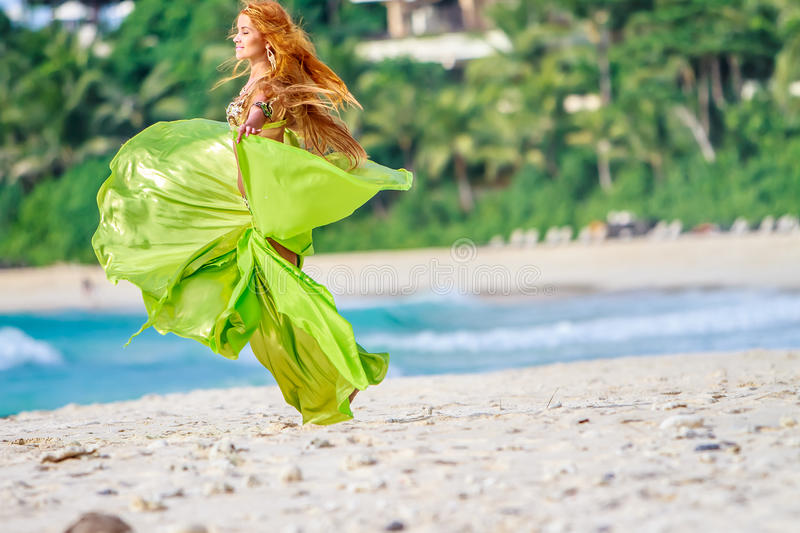 Young beautiful woman on tropical tree background stock image