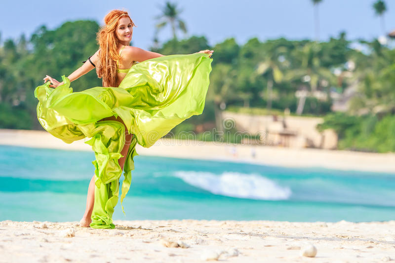 Young beautiful woman on tropical tree background royalty free stock photo