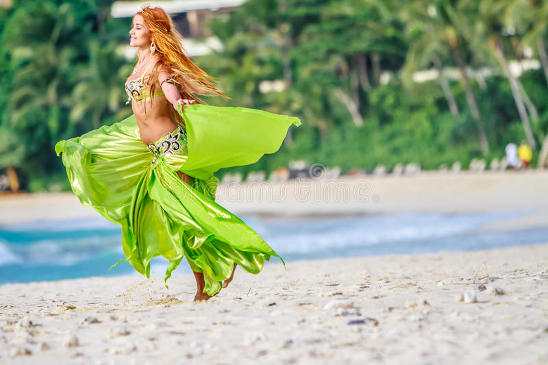 Young beautiful woman on tropical tree background stock photo