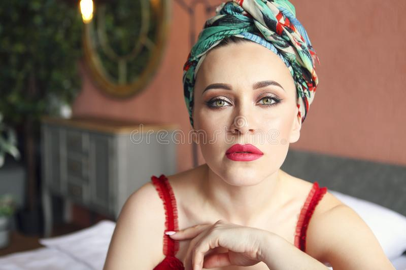 Young beautiful woman in turban royalty free stock photography