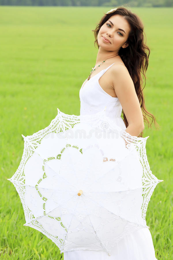 Young beautiful woman with umbrella stock images