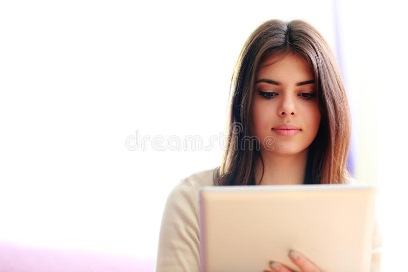 Young beautiful woman using tablet computer stock images