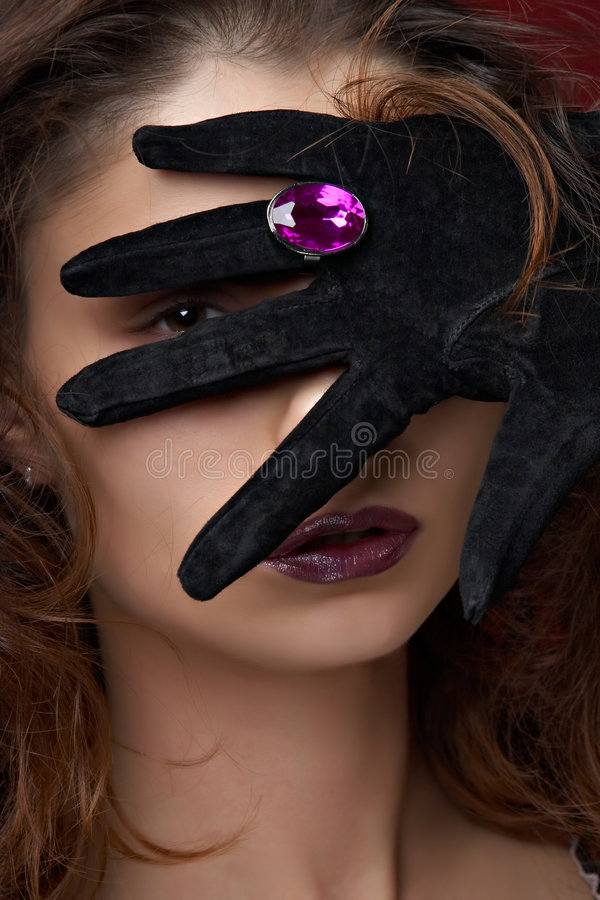 Young beautiful woman with violet jewelry stock images